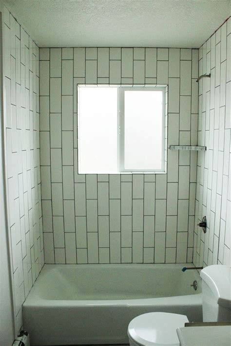 diy tile shower how to tile a shower tub surround part 1 laying the tile