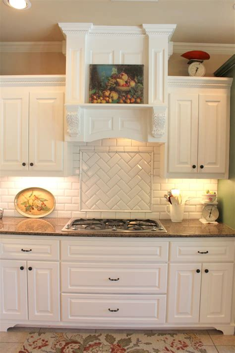 subway or morrocan tile backsplash with white cabinets