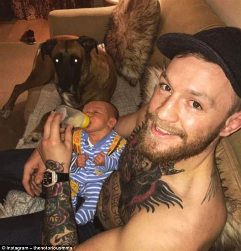 conor mcgregor feeds his newborn daily mail