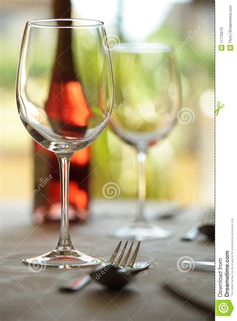 wine glass placement on table wine glass and place setting in a restaurant stock photo