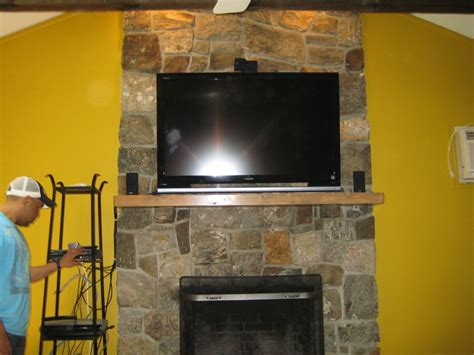 Canaan Ct Tv Install On Natural Stone Above Fireplace