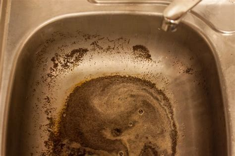 How to Pour Coffee Grounds Into a Kitchen Sink   LEAFtv