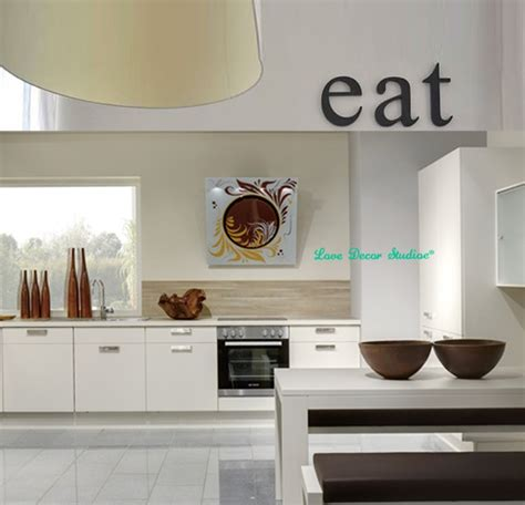 The giant black eating utensils bring visual drama to the scheme. Aliexpress.com : Buy kitchen decor wooden letters EAT Original font Kitchen wall decor kitchen ...