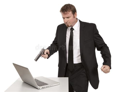 12256 angry businessman stock photo angry businessman points gun at computer stock image