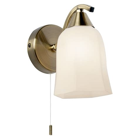 alonso wall light in antique brass with an opal glass