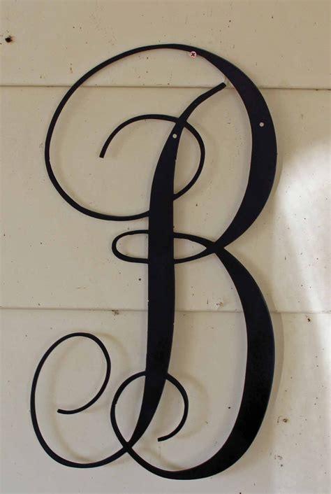 black script metal letter  door  wall