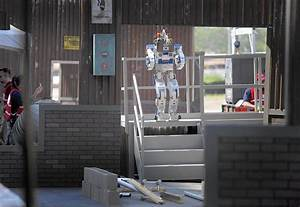 At DARPA challenge, rescue robots show future of disaster ...