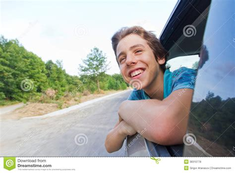 Happy Teenage  Ee  Boy Ee   Leaning Out Of A Car Window Royalty Free