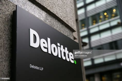 A Deloitte Logo Is Pictured On A Sign Outside The Company