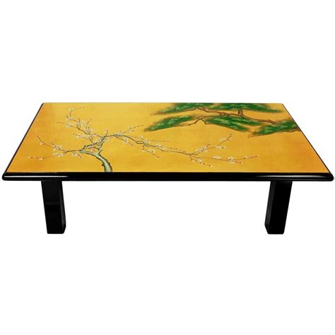 Octopus on world map novelty design with no holder. World Menagerie Maurice Coffee Table | Wayfair