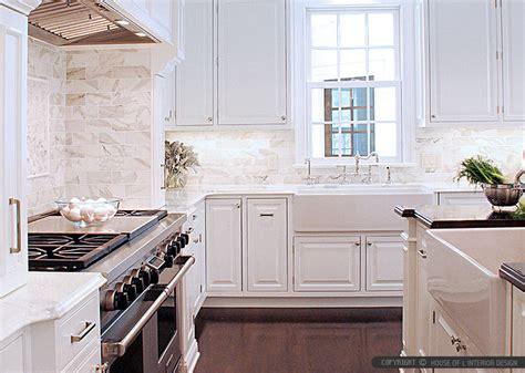 calacatta gold subway tile white kitchen cabinets
