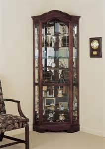 Cabinet Roller by Howard Miller Jamestown Cherry Wood Corner Curio Cabinet