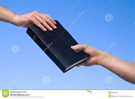 hand giving bible royalty  stock photography image