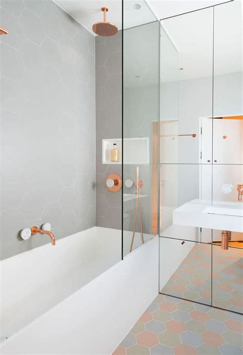 this bathroom features copper and marble fixtures next to
