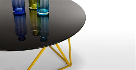 These coffee cups by buffalo china usa bring a bit of the classic diner feel to your own breakfast table. Trigo Coffee Table in smoked glass and yellow   made.com