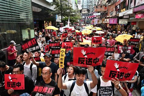 hong kong canadians say changes allowing extradition to china a knife hanging their heads
