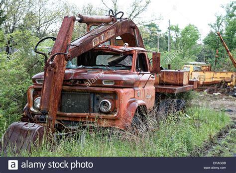 Car Dump Yard by Abandoned Decaying Work Truck In A Roadside Junk