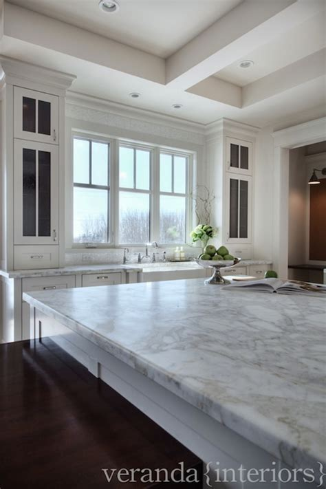 Veranda Interiors by Calcutta Gold Marble Countertops Transitional Kitchen
