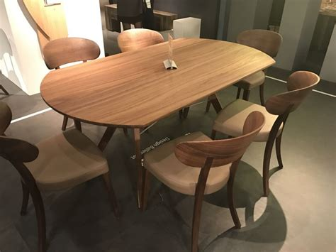 oval dining table designs  symbol  versatility