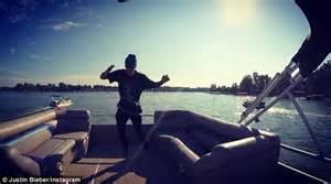 Justin Bieber rocks out on a boat and stands seriously ...