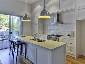 Classic island kitchen design using exposed brick