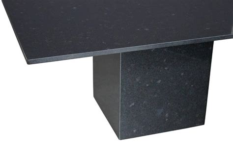 minimalist italian black granite pedestal dining table at