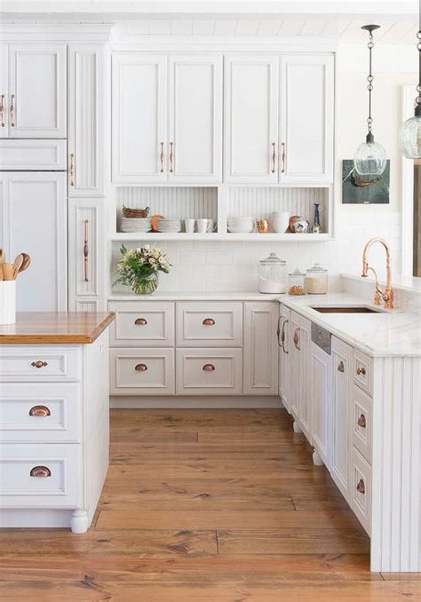 White Kitchen Cabinets With Copper Cup Pulls And Copper