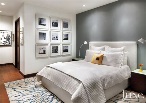 white master bedroom  gray accent wall white wall