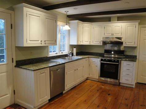 soft white cabinets with rubthrough traditional