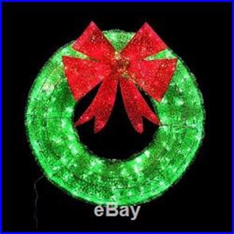green tinsel wreath red bow led mini lights outdoor