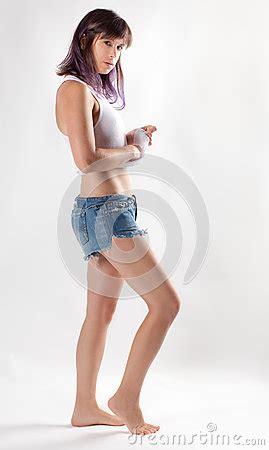 woman  white tank top  jean shorts stock photo