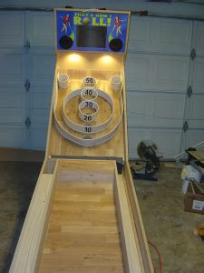 guy  building   skeeball machine incredible