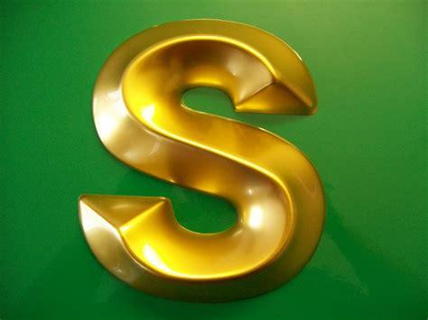 Gold Bevel Moulded Letter On A Green…