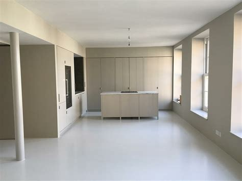 White resin kitchen and dining room flooring