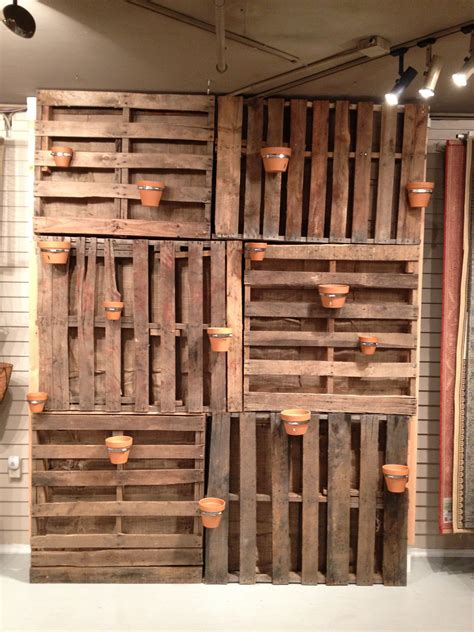 garden wall   pallets added air duct straps