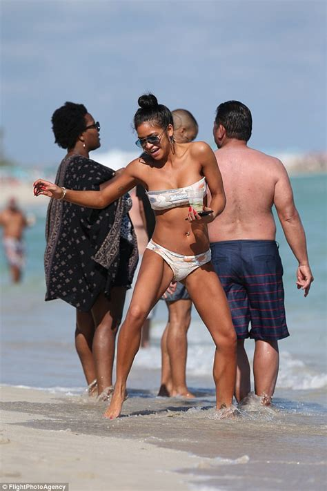 Cassie Ventura strips to her bikini on the beach in Miami