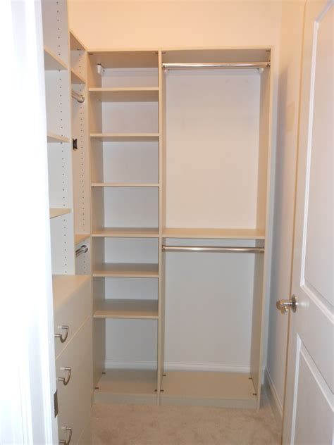 Kitchen Organize Ideas - cream solid wood cabinetery for small walk in closet design with shelves and double clothes