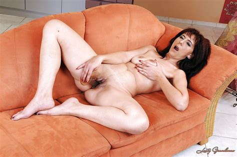 Mature Brunette Gina Red Stripping And Masturbating Her