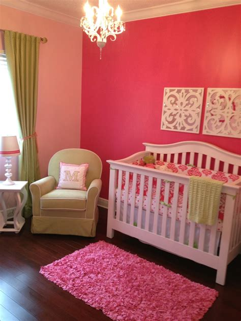 baby girl nursery accent wall with lighter walls