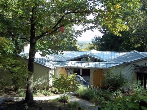 Contemporary Standing Seam Metal Roofing In New Jersey Repair Shed Roof Felt Best 50 Year Shingles Gaf Roofing Ridge Cap Red Inn Albuquerque Candelaria How To Sheet Metal Solar Panel Flat Mounting Systems Cleaning Old Clay Tiles Wash A Convertible