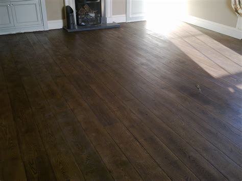 Pine floorboards after floor sanding staining with dark