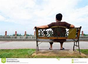 Young Man Sit On The Bench Stock Photography - Image: 33633112