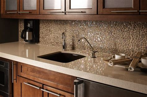 light quartz countertops with honey maple cabinets