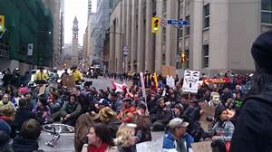 Protesters block rush hour traffic with roaming protest ...