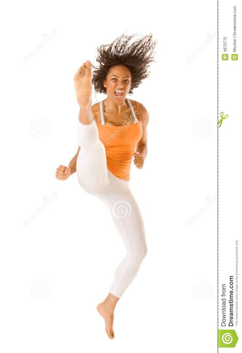 ethnic sports karate woman jumping  kicking stock image