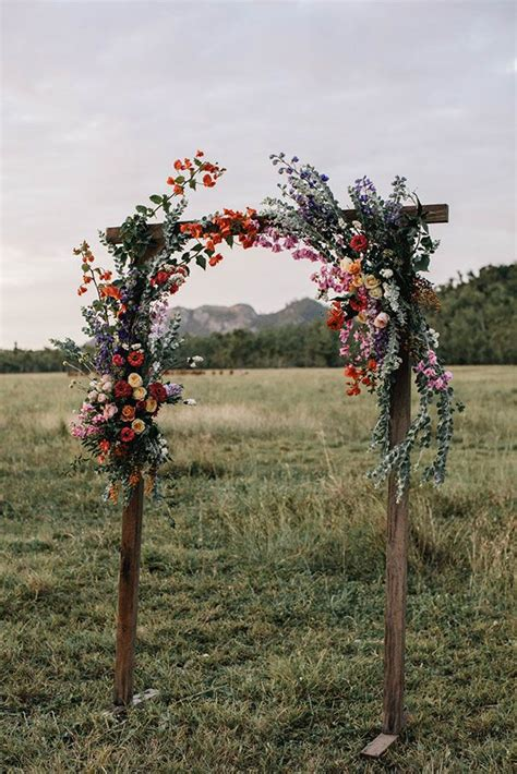 simple wooden floral arch   wedding ceremony