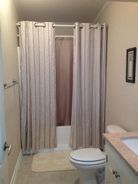 How To Make A Small Bathroom Look Like A Spa by Hanging Shower Curtains To Make Small Bathroom Look Bigger