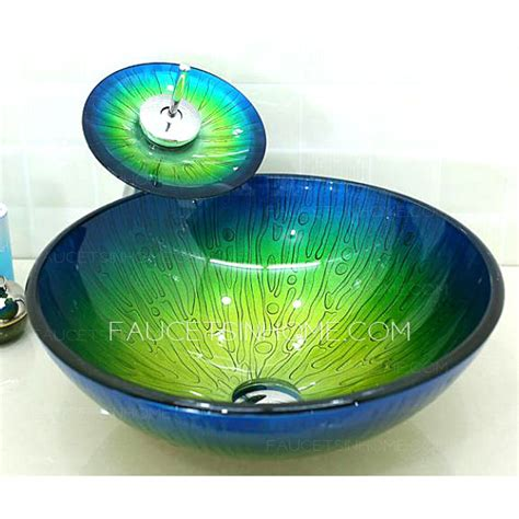 glass vessel sinks blue  green mediterranean faucet