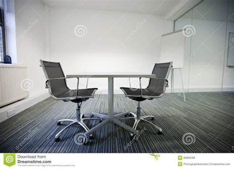 side view of small table and two chairs in office royalty