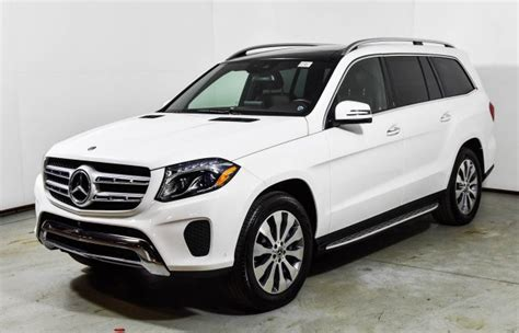 Its interior upgrades include ambient lighting, leather dashboard, special wood trim, and premium porcelain/expresso brown leather upholstery with stitched surfaces. 2019 Mercedes-Benz GLS 450 4MATIC SUV | Polar White U15827